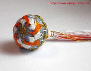 Тэмари с бело-оранжевым цветком
