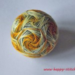Temari with a yellow swirl