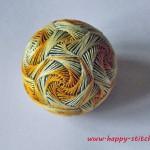 Temari with a yellow swirl