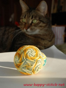 Yellow swirl temari and my cat