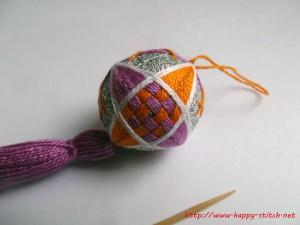 Violet and orange interwoven spindle temari