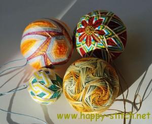 Four temari balls in the sun