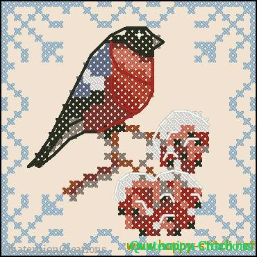 Bullfinch on a brach of rowan free cross stitch pattern
