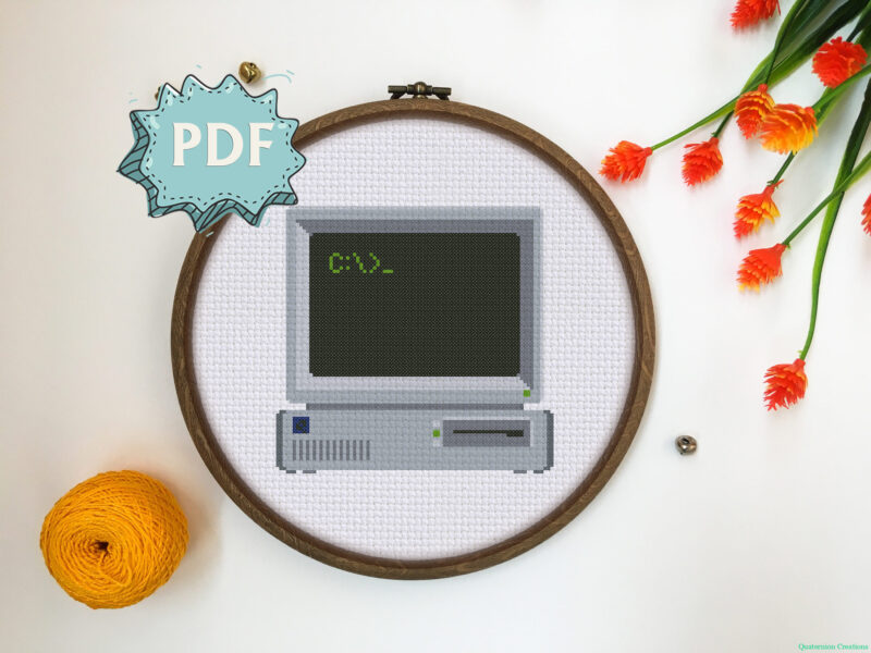 A cross stitch pattern featuring a retro computer with DOS command line.